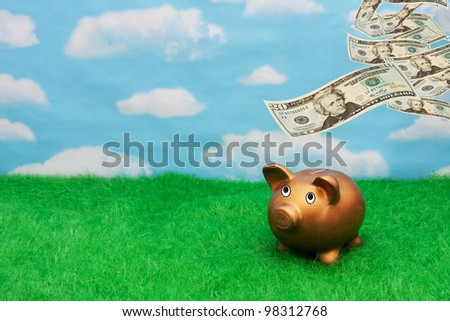 A gold piggy bank on grass with sky background with money falling from sky, Becoming wealthy