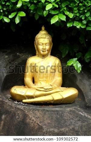 A golden Buddha statue in the garden ,Thai temple ,Thailand