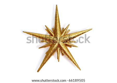 a golden christmas star on a white background