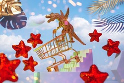A golden dinosaur on wings with a trolley descends the stairs for shopping, around the sky, red stars, palm leaves, the concept of a big sale, Black Friday.