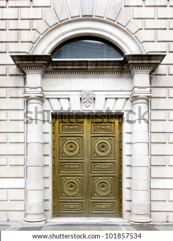 A golden door of a historical building in Madrid, Spain