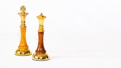 A golden Queen chess piece standing near the Opposing King on a white background