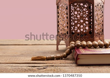 A golden Ramadhan lamp on background #1370487350