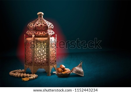A golden Ramadhan lamp with Islamic rosary #1152443234