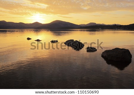 A golden Sunset at Milarrochy bay on the east bank shore of Loch Lomond, Scotland
