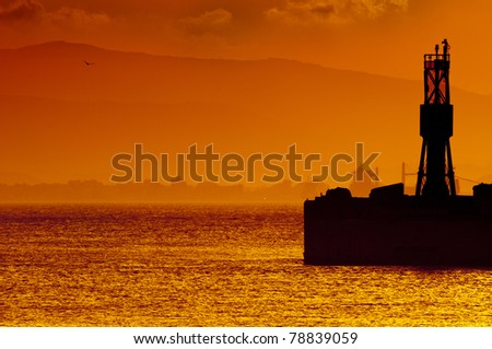A golden sunset over the bay of Gibraltar taken from Gibraltar looking towards Spain. - stock photo