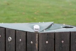 A golf ball on top of a collect basket. Picture from a golf course Scania county, Sweden