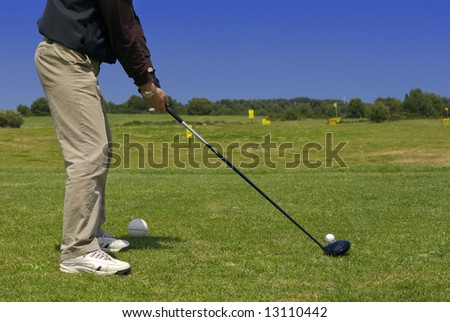 a golf player on the green
