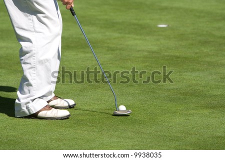 A golfer preparing to attempt a putt