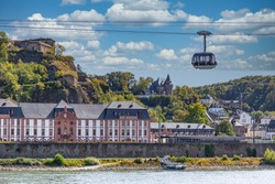 A gondola of the cable car across the river Rhine in Koblenz, Germany, with the fortress and ancient buildings in the background