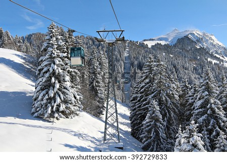 Free photos A gondola transports skiers and snowboarders up a ...