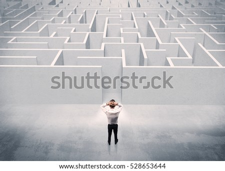A good looking businessman with briefcase standing in front of white labirynth entrance about to make a decision concept - Shutterstock ID 528653644