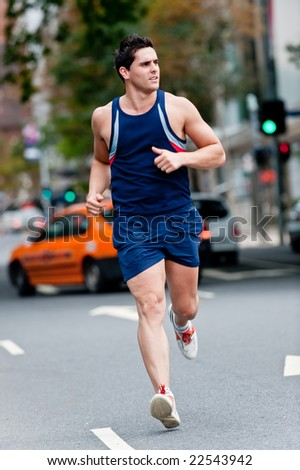 A good-looking man is out running in the city