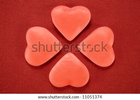 a good-luck four-leaved clover made with heart-shaped candies as leaves