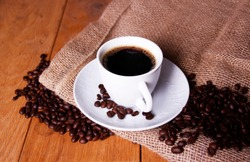A good morning Coffee with coffebeans and jute bag