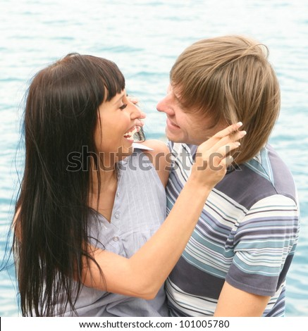 A gorgeous couple roaming at the sea shore