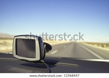 A GPS device placed in the car's cockpit