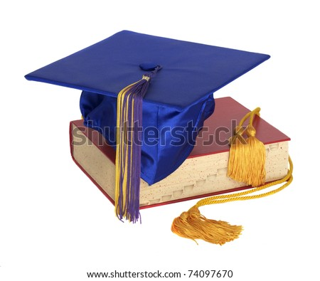 A graduation hat and honor cord on top of a text book
