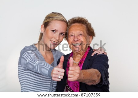 a granddaughter visits her grandmother. laughter and joy. thumbs up
