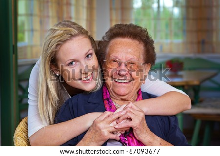 a grandson to visit his grandmother. fun and pleasure in the embrace.