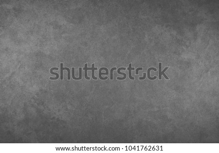 A gray black wall for inscriptions. Graphite wall. Wall for ads. Blackboard. #1041762631