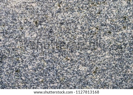A gray marble wall into a large black dot. Textural background. Wallpaper #1127813168