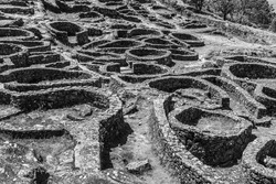 A grayscale shot ofhe ruins of the ancient Celtic village by the sea in Santa Tecla, Galicia, Spain