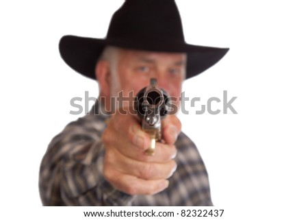 A great image of a man holding a gun directly at the viewer.  The man is out of focus and the gun is in focus.