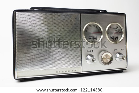 a great looking vintage portable silver radio with cool FM and MW dials