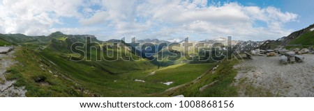 A great panorama or panoramic view of mountains from the highest surfaced mountain road in Austia - Grossglockner High Alpine Road. This panorama is good for a banner or a background.
