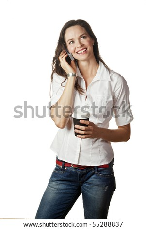 A great portrait of an attractive casual young woman talking on her mobile and holding a take away coffee