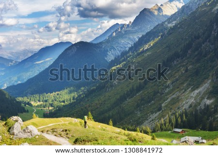 A great warm autumn in France in the Alpine mountains on tourist paths with magnificent views around. #1308841972