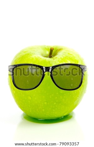 A green apple isolated against a white background