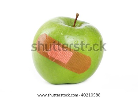 A Green apple with a band-aid on it.
