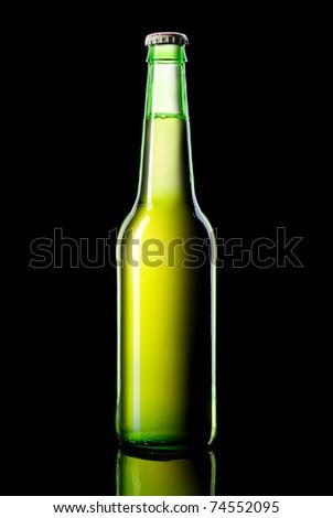 a green bottle beer on a black background