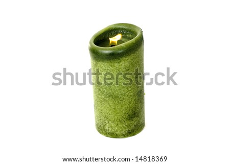 A green candle on a white background.