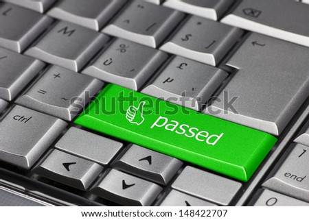 A green computer key with thumb up to indicate you've passed