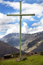 A green cross located in the mountains of Peru.