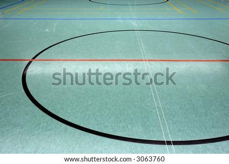 a green floor in a gymnasium