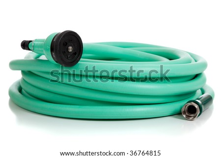 A green garden hose with a sprayer on a white background