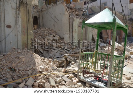 A green gazebo on top of a pile of rubble in Havana, Cuba.