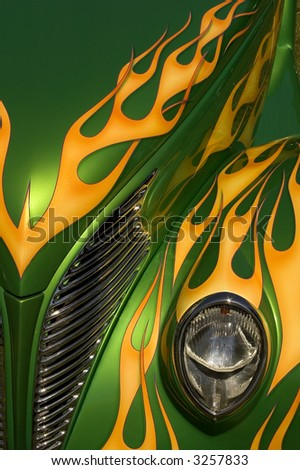 A green hot rod with yellow flames.