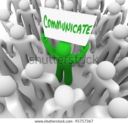A green person stands in the middle of a crowd or audience and holds a sign reading Communicate to provoke a discussion or share an idea