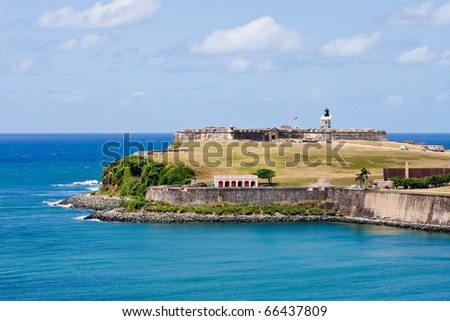 A green public park outside an ancient fort on the coast of Puerto Rico