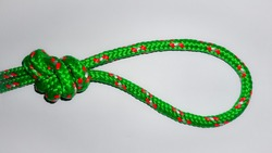 A green rope with double figure of eight knot. It is frequently used inclimbingandcavingas an easily untie-able knot that is capable of being attached to two bolts and equalised.