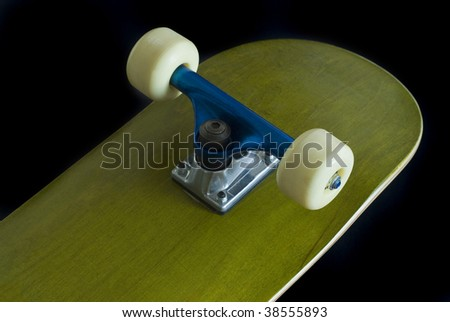 a green skateboard deck with blue truck on a black background