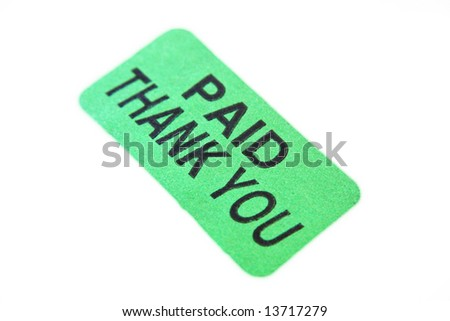 A green sticker with the words Paid Thank You
