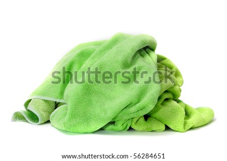 a green towel isolated on a white background