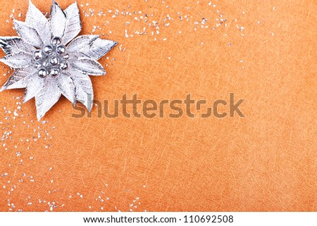 a greeting card with silver flower and glittering