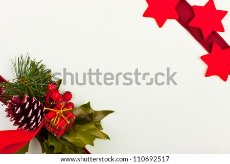 a greeting card with stars and pine cone